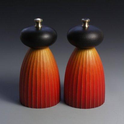 Louise Hibbert orange-and-black-salt-and-pepper-mills, sycamore, brass